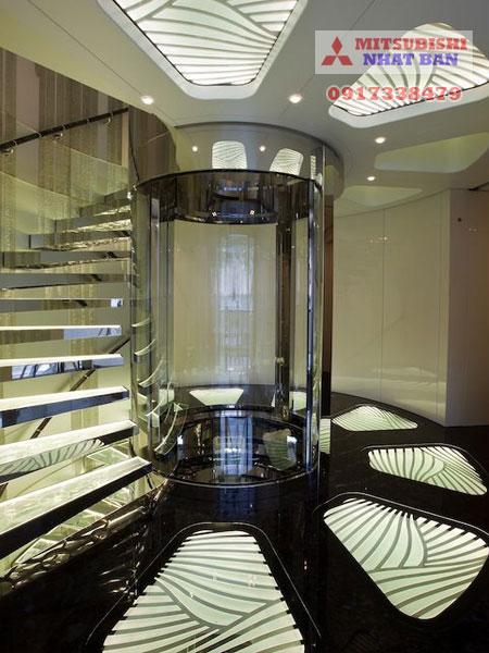mẫu 4 thang máy gia đình ốp kính loại nhỏ hình trụ