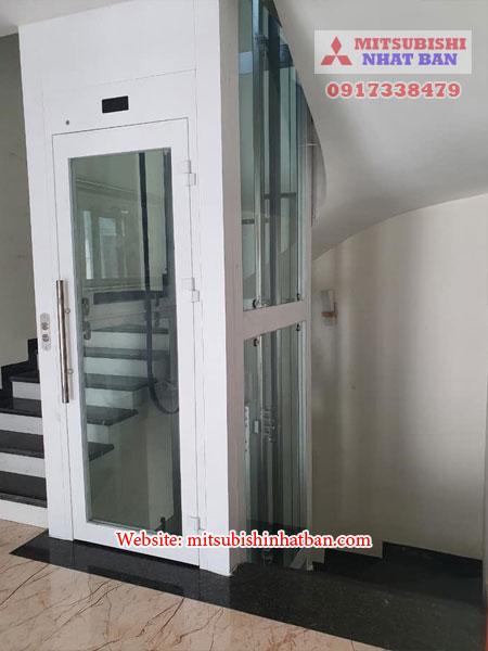 thang máy mở cửa bằng tay 1